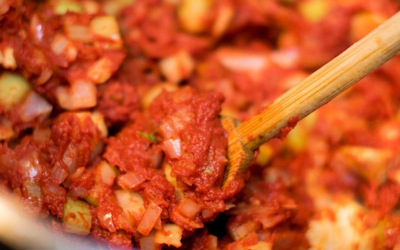 Stirring in the tomato paste