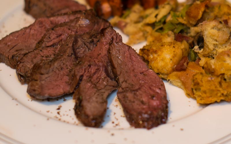 Roasted bison hanger steak with savory bread pudding
