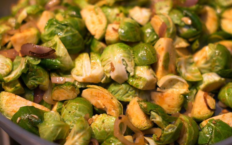 Brussel sprouts cooking in pan