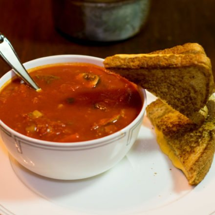 Grilled cheese going headlong into tomato soup