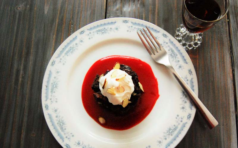 Chocolate amaretto bread pudding with cherry amaretto coulis