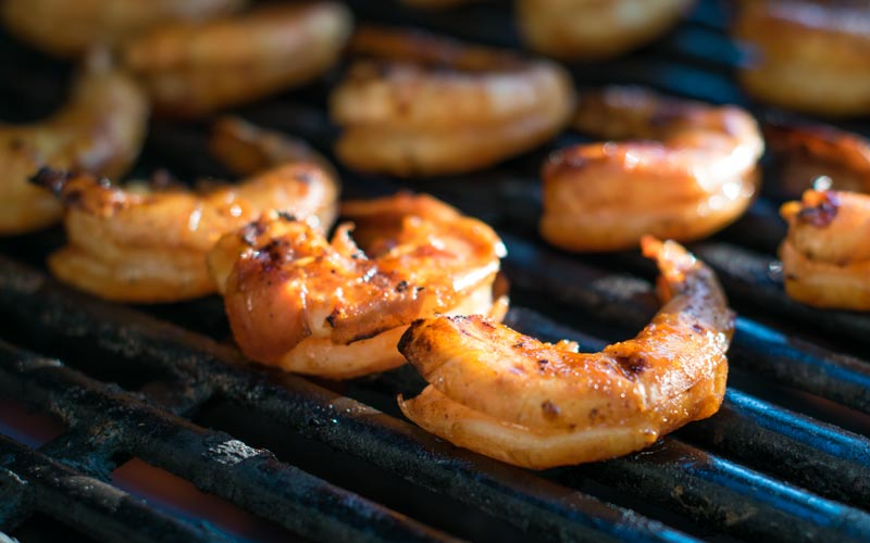 Adding the olive oil and lemon juice help keep the shrimp from sticking to the grill