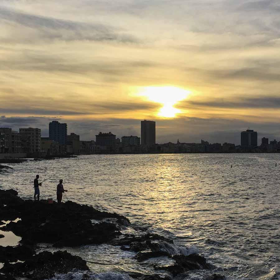 Fishermen along the Malecón at sunset