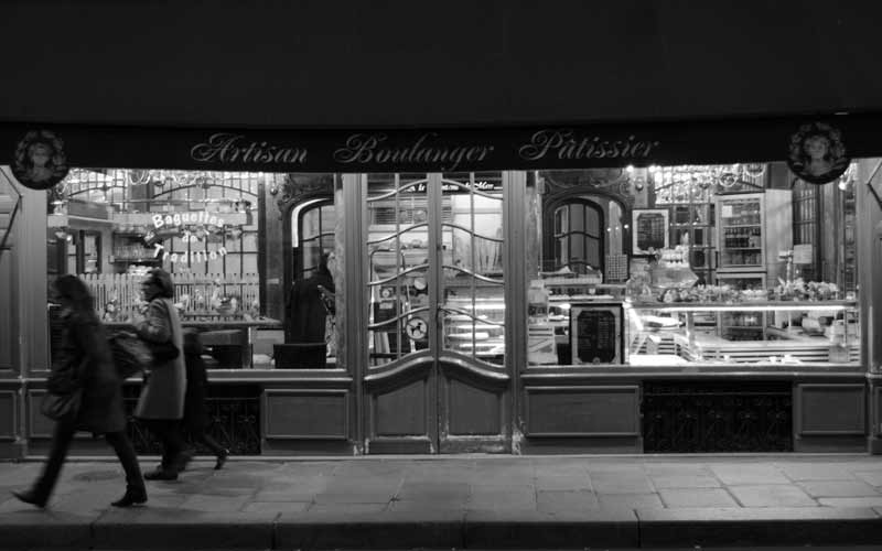 A pastry shop at dusk