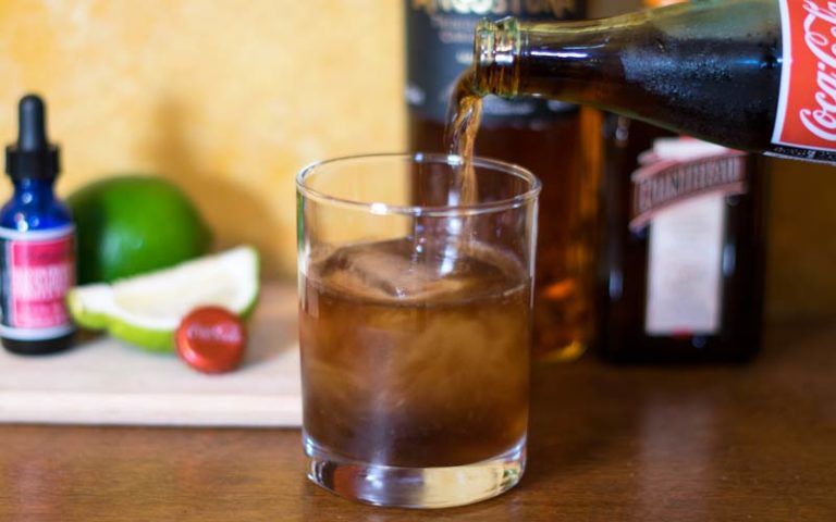 Pouring the Coke into an Old Fashioned Cuba Libre