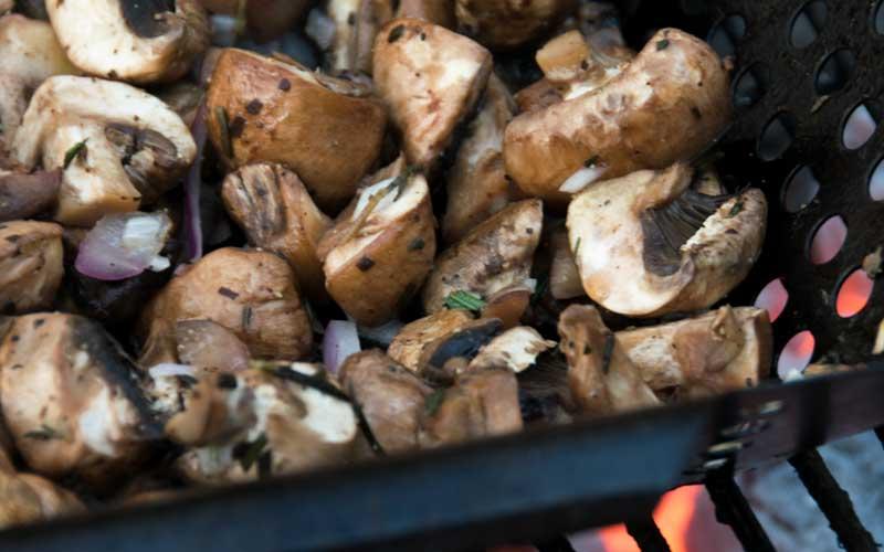 Mushrooms being grilled