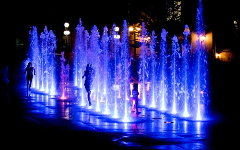 Playing in the fountain at night