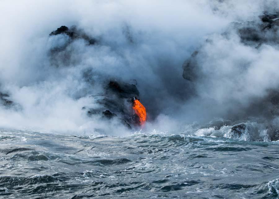 Lava Slipping Under Rocks