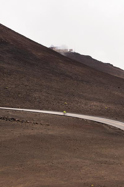Biker speeding down Haleakala