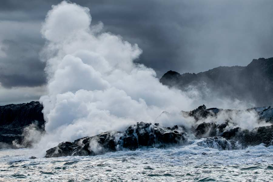 Acidic steam drifts off the hot rock
