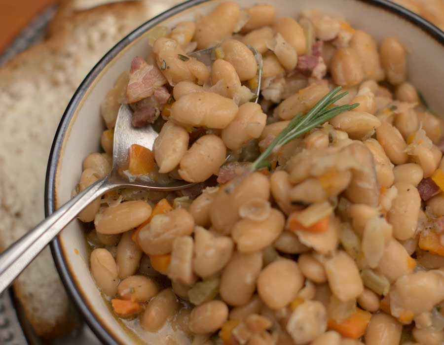 White Beans and pancetta On Spoon